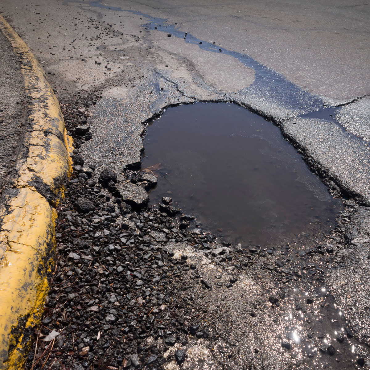 pot hole in road surface