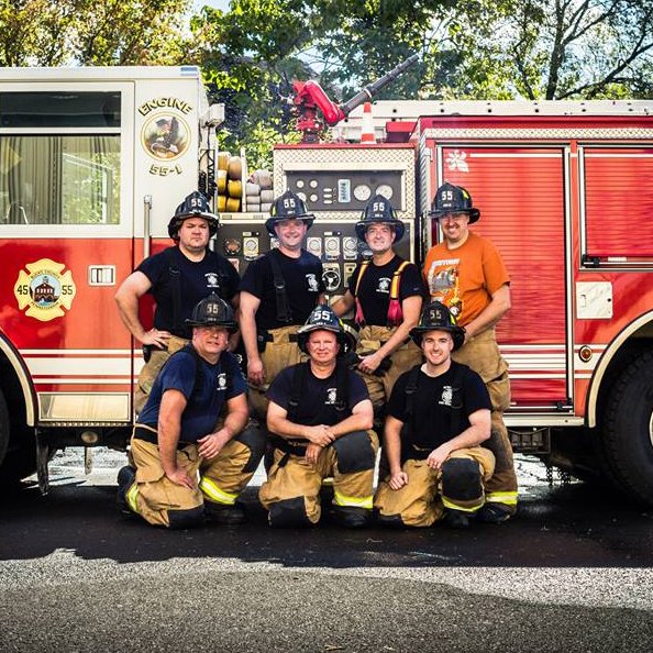 Newtown Emergency Services Department Group Shot in front of engine